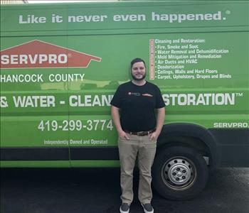 male Operations Manager Picture in front of green van